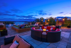 Dusk on the rooftop Terrace at JW Marriott The Rosseau Muskoka Resort & Spa, one of many inviting common areas at the lakeside resort in Minett, Ontario Canada, 2.5 hours north of Toronto.