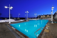 "This heated, indoor-outdoor main swimming pool is only one of dozens of recreation options at JW Marriott The Rosseau Muskoka, in Ontario's popular ""cottage country""."