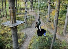 Braha Paull in action as she swings into a cargo net during her climb towards Second Place at Sandy Spring Adventure Park's Iron Monkey Challenge. (Photo: Outdoor Ventures)