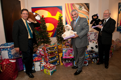 A portion of the toys collected at this years event. (left to right) Rory Sanchez, CEO of SLPowers; Sam Ruggeri, President of AVTG;Bob Hochmuth, SLPowers Sales VP.