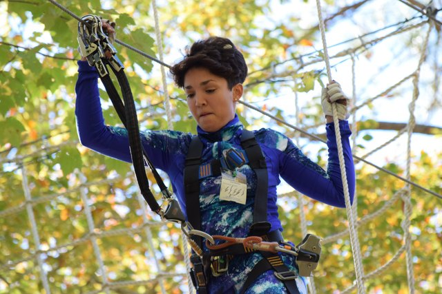 "Emmanuela (""Emmy"") Nazario - Iron Monkey Challenge First Place Winner, displays the climbing concentration that led her to victory. (Photo: Outdoor Ventures)"