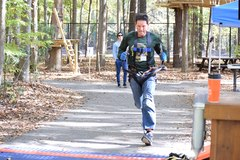 "Richard (""Doc"") Guinand races to the finish line to win First Place in the Going Commando Challenge. He also won Third Place in the Iron Monkey Challenge. (Photo: Outdoor Ventures)"