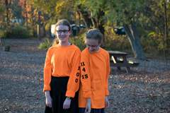 Bracha (left) and Chaya Paull examine the shirts custom-made in honor of their 100th climb at The Adventure Park at Sandy Spring, MD. (Photo: Outdoor Ventures)