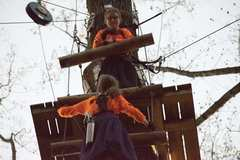 """Chaya Paull climbs up to join her sister, Bracha on a platform of their favorite aerial trail, """"Black Storm."""" (Photo: Outdoor Ventures)"""