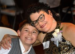 Dr. Stacie Grossfeld with son Adam at the Mellwood Arts Center during the 2016 EPIC Award Ceremony hosted by NAWBO Louisville.