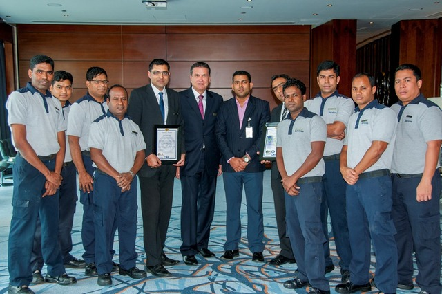Mr. Suraj Veetil from Quality Registrar Systems presents the certificates to Mr. Stefan Gaessler, General Manager of Hyatt Capital Gate Abu Dhabi and his Team.
