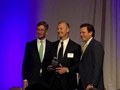inwhatlanguage CEO, Cody Broderick, receives UTC Emerging CEO award from Richard Nelson