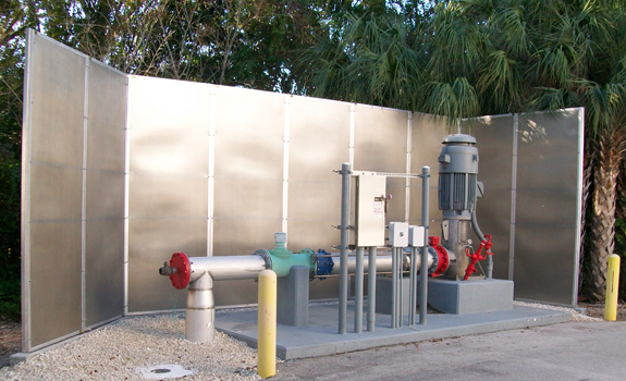 An assembly of nine Acoustiblok Hurricane All Weather Sound Panels acts as a noise barrier and sound absorber around the water treatment plant's pump station.