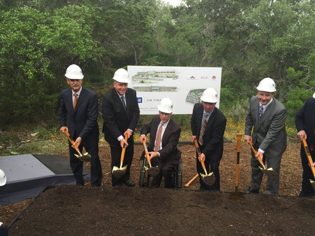 Governor Greg Abbott and other dignitaries break ground at the GM Financial Service Center, to be constructed by Bob Moore Construction