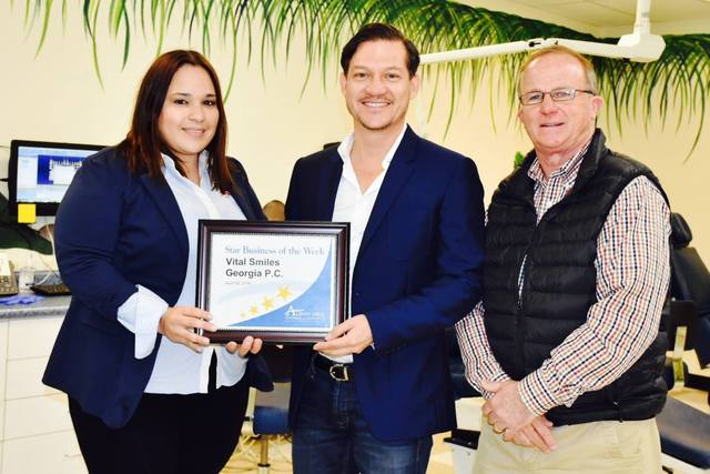 Dr. Hernandez receives the Star Business of the Week award.