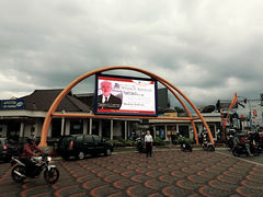 Professor Slomanson in front of billboard in Indonesia promoting his lecture.
