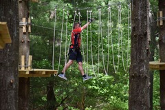 "Dan Pendergast ""Walks on Air"" on one of the Tree Trails at TreeTop Adventures."