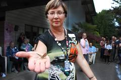 Karen Baillie, CEO, releases a butterfly at the Butterfly Release Celebration held to honour, celebrate and remember residents and family who live in residential care or recently passed away.