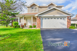 Property Up offering home with finished basement offered in Oakwood Landing Subdivision