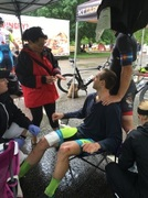 Dr. Grossfeld often serves as the physician for local sporting events to treat injured athletes. In this photo, she is the sports doctor for a cyclo-cross competition.