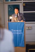 Alumni Association President Jeremy Evans '11 introducing Dean Guernsey