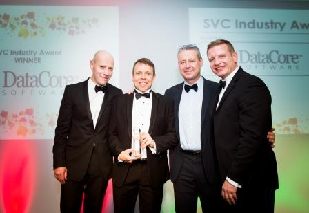 Brett Denly (Regional Director), Neil Crispin (Account Director), Pierre Aguerreberry (Director, Enterprise Sales) collect award from SVC organiser/Director of IT Publishing, Jason Holloway.