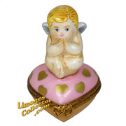 Cupid on a Pink Heart Limoges Box. The cutest cupid cherub Limoges boxes for Valentine's Day at LimogesCollector.com