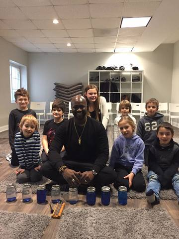 Ofosu with kids from class