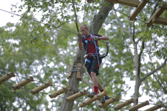 A young adventurer navigates one of the aerial trails at The Adventure Park. (photo: Outdoor Ventures)
