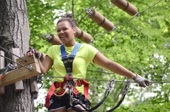 A climber pauses to savor the moment at one of The Adventure Park's treetop platforms. (Photo: Outdoor Ventures)