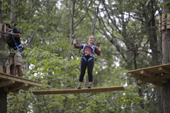 The Adventure Park is much more than just zip lines. This climber is navigating one of the challenge crossings between tree platforms. (Photo: Outdoor Ventures)
