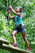 The Adventure Park is more than just zip lines--as this determined young lady demonstrates. (Photo: Outdoor Ventures)