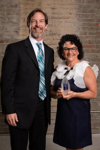 Dr. Grossfeld accepts her award for the 2017 Volunteer of the Year from Mike Bramer, the District Executive Director at the YMCA at Norton Commons.