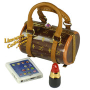 Mom will be impressed with this fashionable designer purse Limoges box.  Buy it at LimogesCollector.com