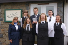 The award-winning team at Hotel Petit Champ in Sark - manager Carl Cowell holds their prize from the Considerate Hotel Awards