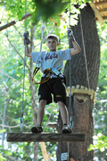 "A young visitor enjoys one of the ""aerial bridges"" at the Outdoor Adventure Park at Sandy Spring, Maryland (another Park built and operated by Outdoor Ventures Group, LLC)"