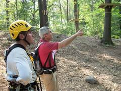 Bahman Azarm (right) Outdoor Ventures Group partner, discusses the finer points of aerial park construction with one of the crew members at the Adventure Park at the Discovery Museum site.