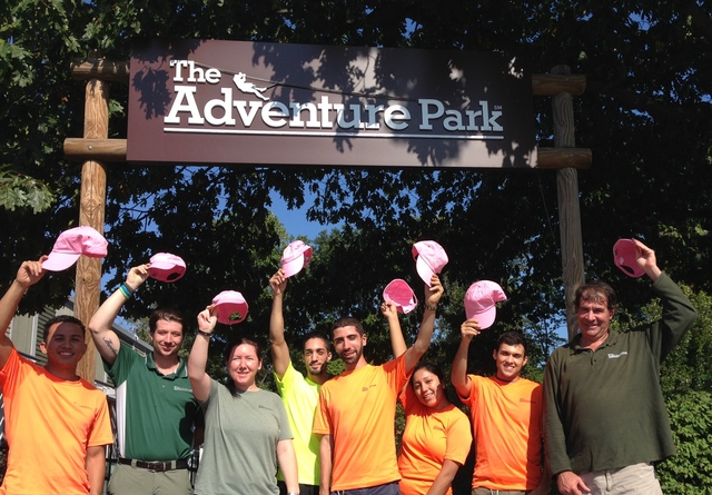 Staff of The Adventure Park at The Discovery Museum will wear and sell pink caps to raise funds to fight breast cancer this October.
