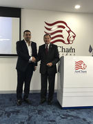 V.B. Balrai Singh shakes hands with Governor Gary Herbert, Governor of the State of Utah, at the American Chamber of Commerce Singapore.