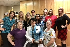 Dr. Grossfeld and her team at Orthopaedic Specialists PLLC celebrate winning the 2017 Business of the Year Award.