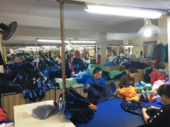 Factory workers working on sports apparel at the sewing section of the sports apparel factory