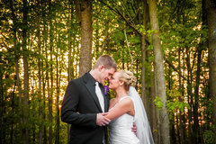 Bride and groom outside their wedding reception in a wooded area.  Adam Shea Photography captured their wedding.