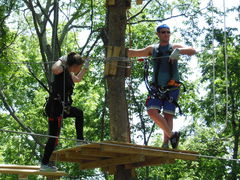 Two climbers pause a moment on one of the many tree platforms along the courses at The Adventure Park at Nashville.