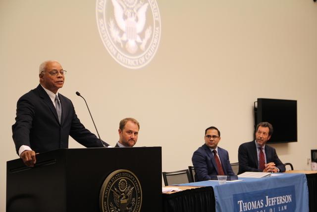 The Hon. John Houston (speaking), Brian Findley, Srinivas Hanumadass, and Randy Mize