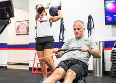 An F45 Middletown member uses a rowing machine during his workout. With over 30 different workouts that use 3,500 different exercises, members don't get bored with their workout routine at F45.