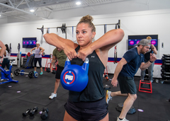 A current member of F45 Middletown in Louisville, Kentucky uses a kettlebell during her workout. Each F45 location features a variety of gym equipment that is used during every workout session.