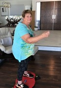 76 yo Simply Shuffle mom working out on no impact Simply Shuffle board developed by fitness researcher Ed Gaut.  Simply Shuffle was designed to provide weight loss with no impact.