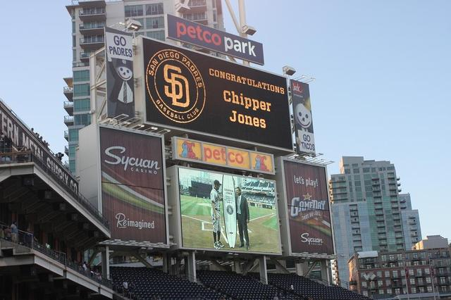 Chipper Jones Receiving His Custom South Coast Surfboard from the San Diego Padres
