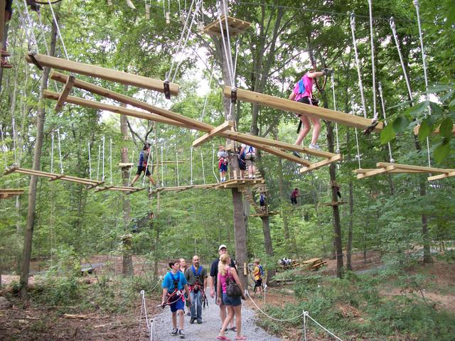 Kids, teens and adults enjoy the different challenge levels offered at The Adventure Park at The Discovery Museum in Bridgeport, Connecticut. (Photo by Anthony Wellman)