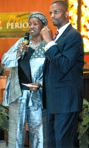 (L) Hattie Smith-Miles presented with an honorary donation for the House of Acts by (R) Rev. Dante Quick of Friendship Missionary Baptist Church in Vallejo, Calif.